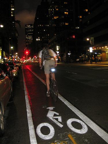 a cyclist in a bike lane in manhattan