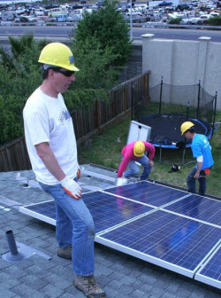 grid alternatives volunteers installing a solar system
