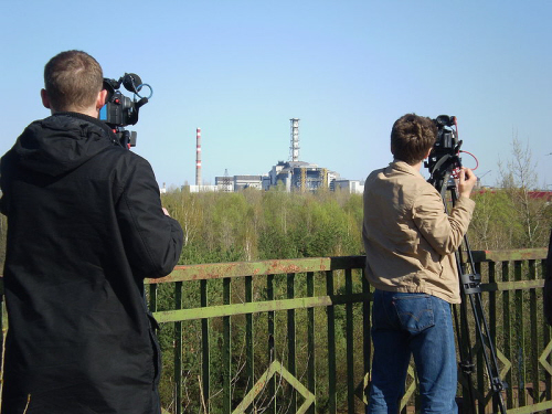journalists photographing site in chernobyl