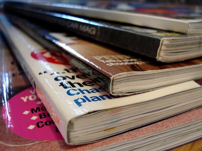 a stack of glossy magazines