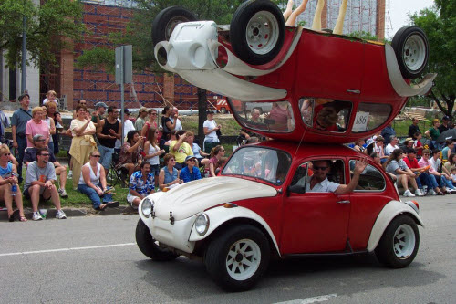 two volkswagen beetles on top of one another as one vehicle
