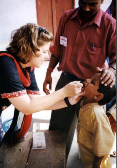 a young boy receives polio vaccination