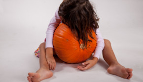 hugging a pumpkin
