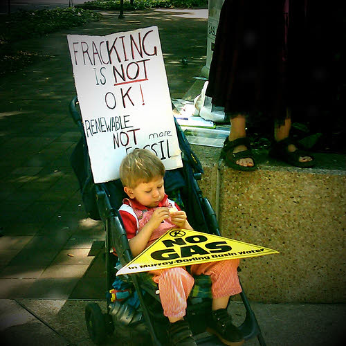 a child at a protest of the dangers of fracking