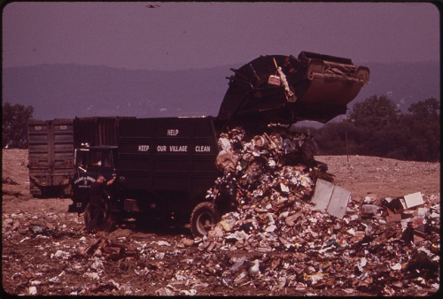 a sign of a throwaway society: a garbage dump