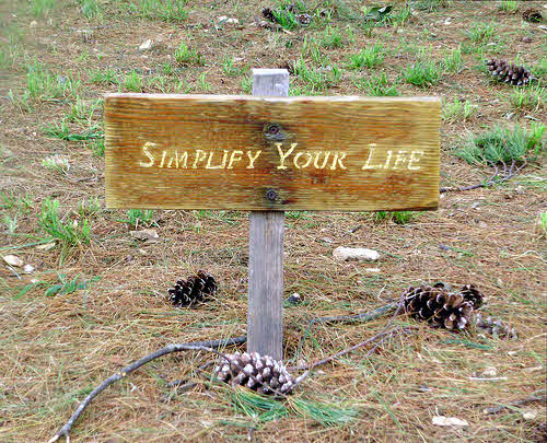simple living sign reads simplify your life