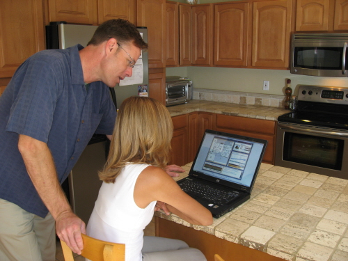 a couple makes use of a home energy management system