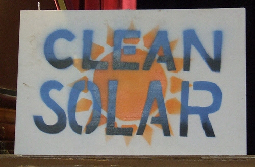 clean solar protest sign