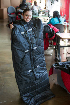 Empowerment Project founder Veronika Scott models a coat