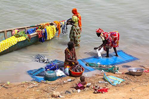 women doing laundry in africa