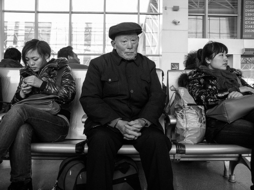 senior citizen at a bus station