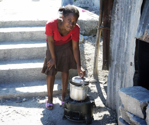 girl cooking with an ecorech clean cook stove