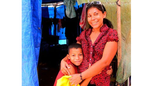 consuelo castillo and her son in their land reform community