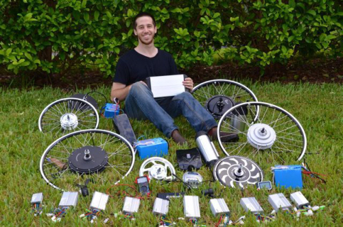 micah toll surrounded by diy electric bike parts
