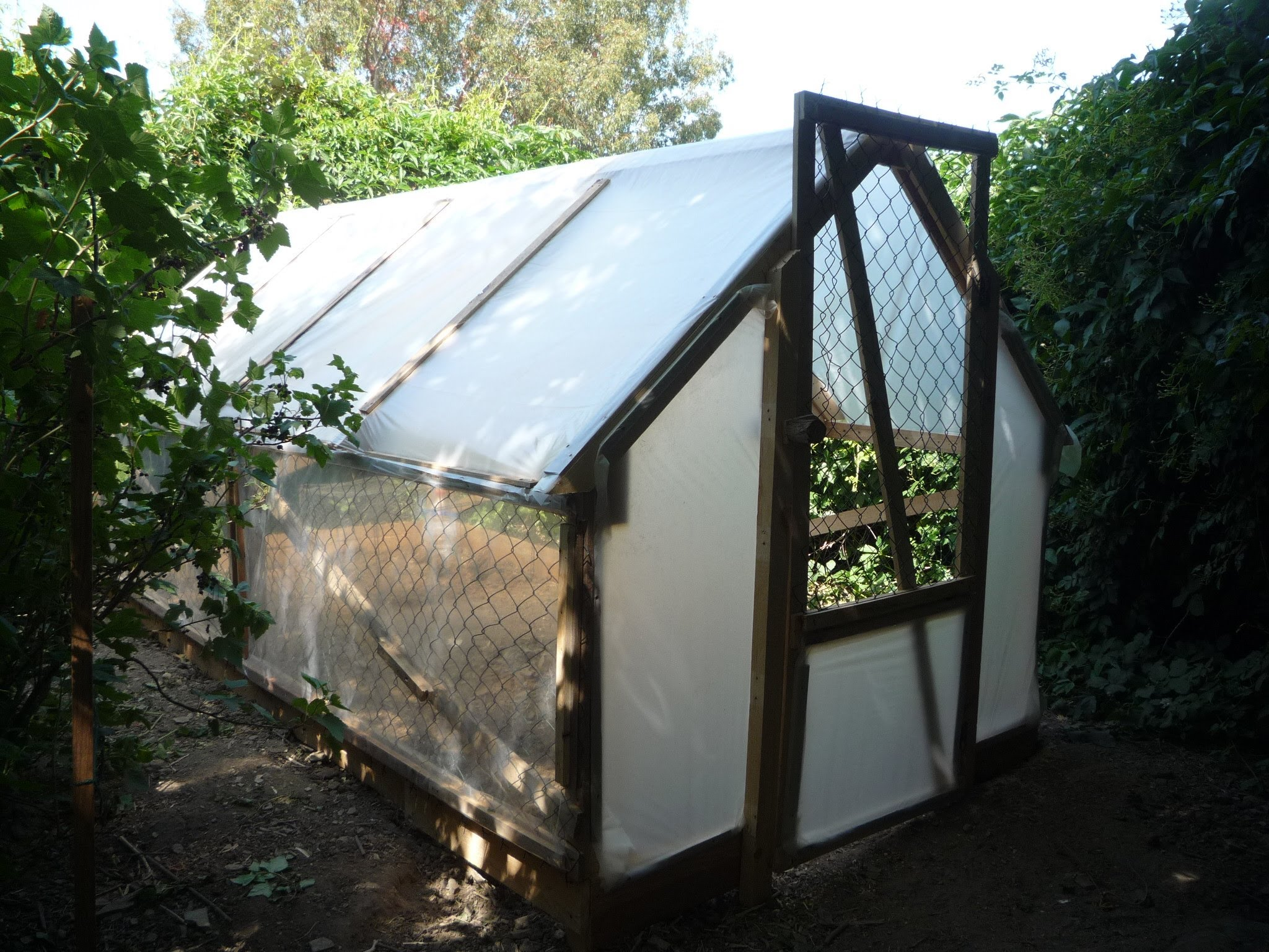 The diy greenhouse from upcycled materials 5 plans for Materials to make a greenhouse