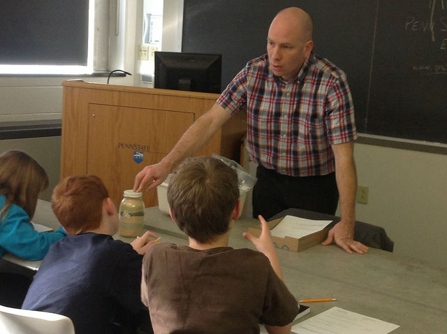 teacher sharing climate change facts with students