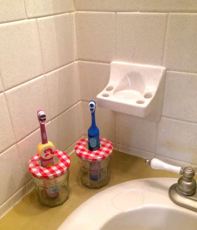 finished jam jar toothbrush holders
