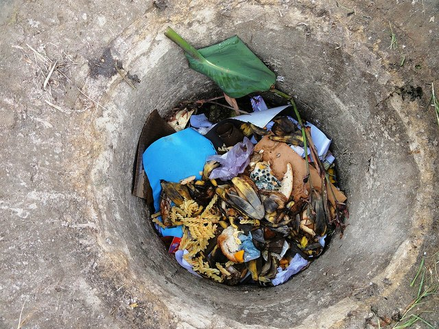 organic waste in collection bin of in-ground biogas plant