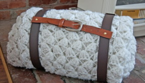 firewood or blanket caddy made from old belts