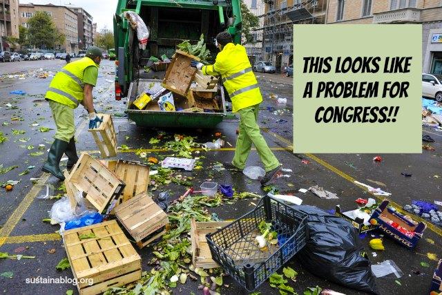 workers throwing food waste in a garbage truck